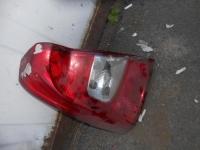 Фонарь левый задний Renault Logan 2005>